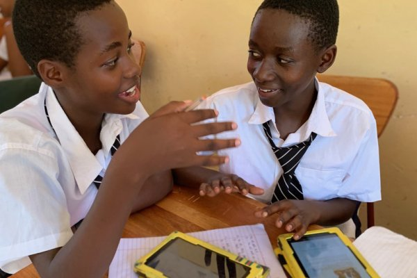Two students work together at Mtakuja Secondary School.